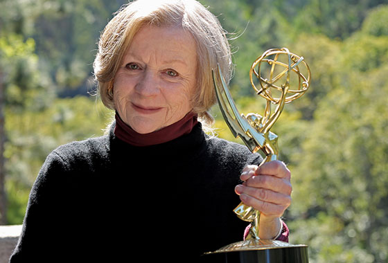 Molly Harris Campbell holding Emmy Award