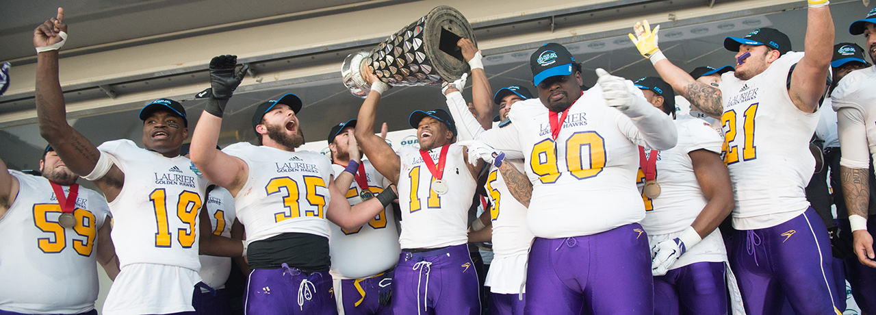 Laurier players celebrate their Yates Cup football victory.