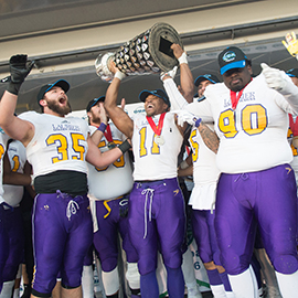 Laurier football players celebrate their Yates Cup victory.