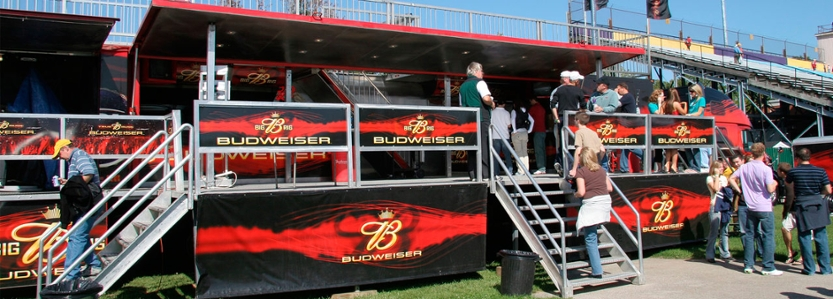 Budweiser truck is parked on the stadium field at homecoming