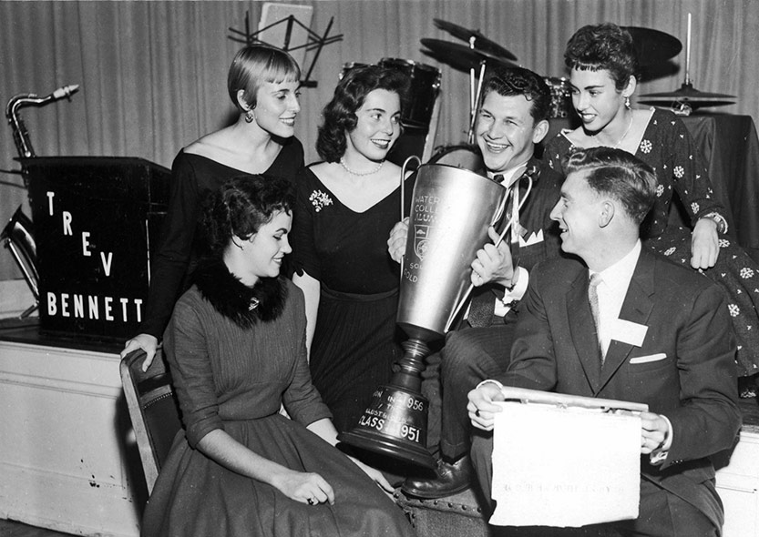students pose with the gold cup in 1957