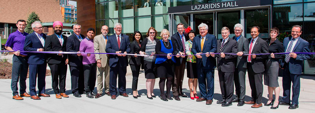 laurier faculty, staff and donors participate in ribbon cutting outside Lazaridis Hall