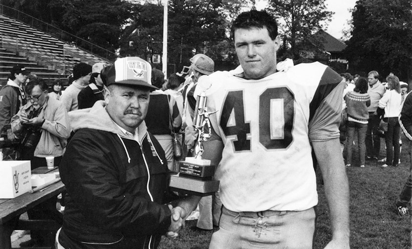 tuffy knight poses with football player in 1984