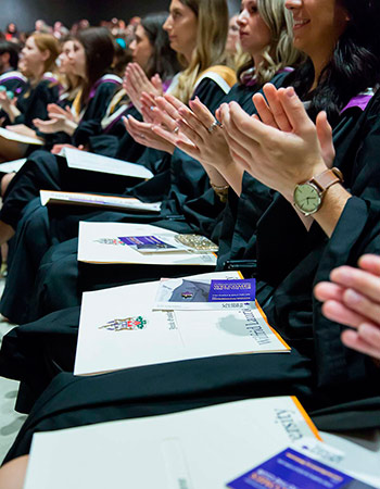 students clapping in audience at spring convocation 2017