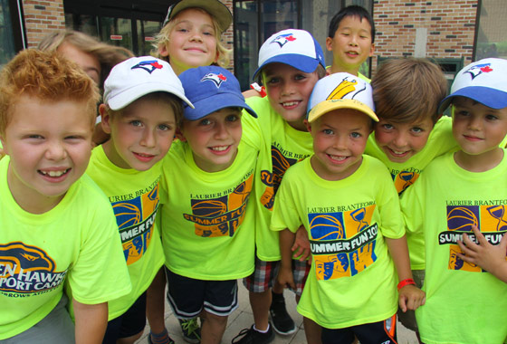 group of kids smiling at camera at a day camp in Brantford