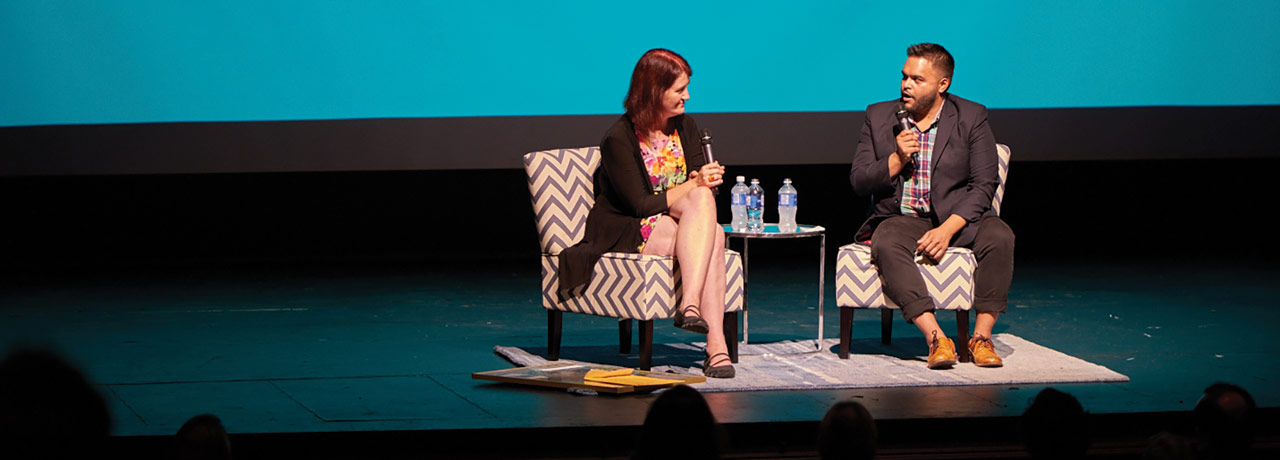 Ravi Srinivasan interviewing Emma Donoghue on stage  at the South Western International Film Festival.