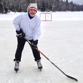 Robert Gignac is photographed playing pond hockey.